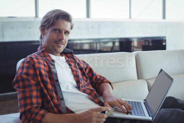 Stock photo: Portrait of entrepreneur shopping online with credit card