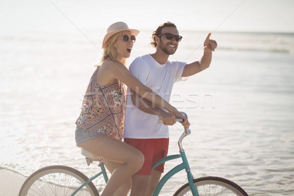 Happy couple riding bicycle at beach Stock photo © wavebreak_media