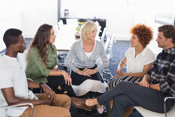 Komoly üzletemberek megbeszél iroda ül székek Stock fotó © wavebreak_media