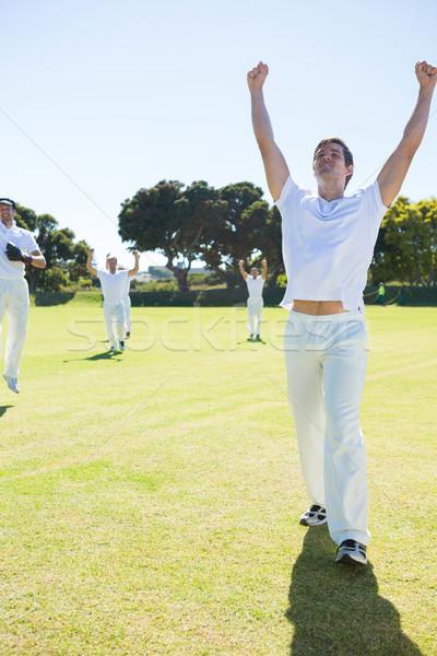 Gelukkig cricket spelers genieten overwinning permanente Stockfoto © wavebreak_media