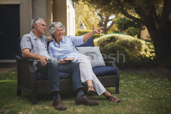 Stock photo: Happy senior couple sitting together on couch