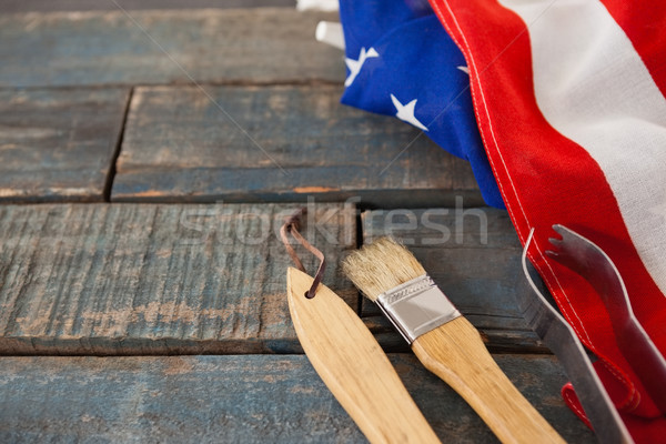 Basting brush and tong with American flag on wooden table Stock photo © wavebreak_media