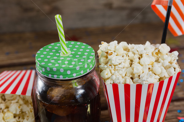 Close-up of popcorn and cold drink Stock photo © wavebreak_media