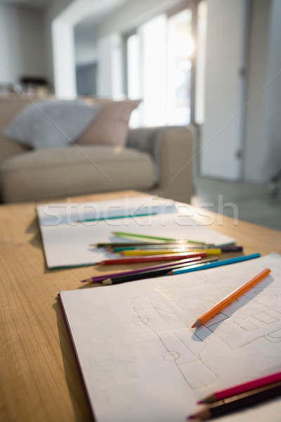Books and pencils on a table in the living room Stock photo © wavebreak_media