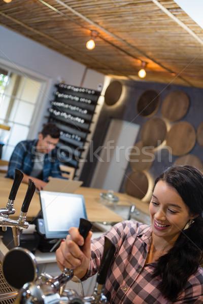 Beautiful barmaid preparing drink Stock photo © wavebreak_media