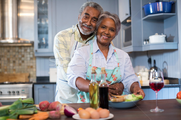 Portriat of smiling senior couple preparing food Stock photo © wavebreak_media