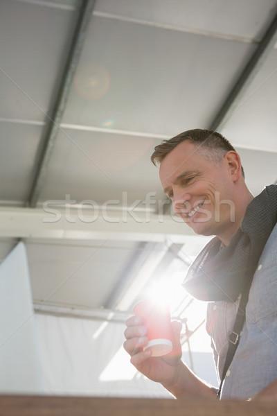 笑みを浮かべて ビジネスマン ドリンク デスク オフィス ストックフォト © wavebreak_media