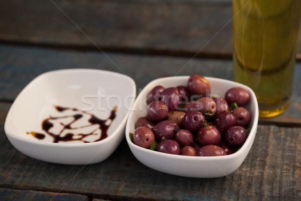 ストックフォト: ブラックオリーブ · コンテナ · ボトル · シロップ · 木製のテーブル
