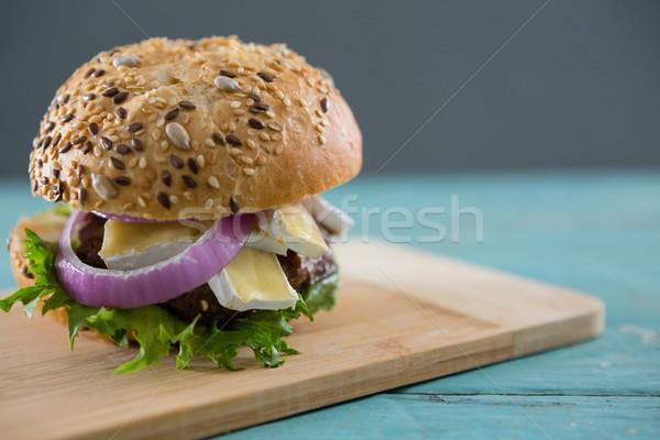Burger requesón tabla de cortar mesa pared Foto stock © wavebreak_media