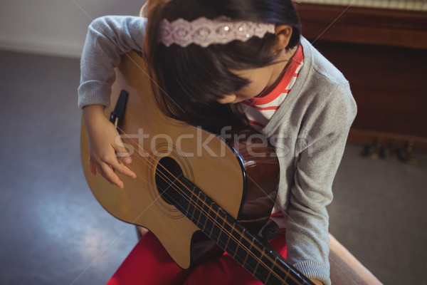 High angle view of girl practicing guitar Stock photo © wavebreak_media