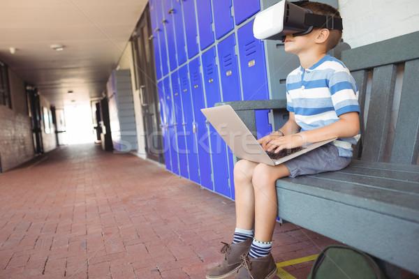 Fiú laptopot használ virtuális valóság szemüveg ül Stock fotó © wavebreak_media