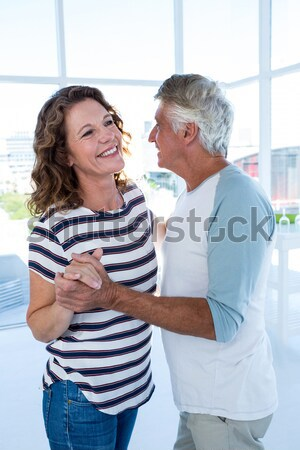 Female doctor assisting man in standing at nursing home Stock photo © wavebreak_media