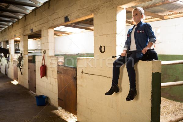 Girl sitting in stable Stock photo © wavebreak_media