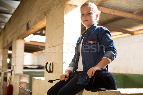 Girl sitting in the stable Stock photo © wavebreak_media