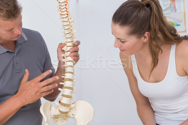 Doctor showing anatomical spine to his patient  Stock photo © wavebreak_media
