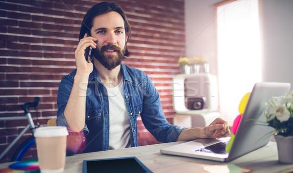 Retrato empresário falante telefone criador escritório Foto stock © wavebreak_media