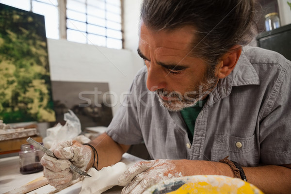 Close-up of attentive man molding sculpture Stock photo © wavebreak_media