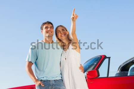 Man with woman pointing by off road vehicle Stock photo © wavebreak_media
