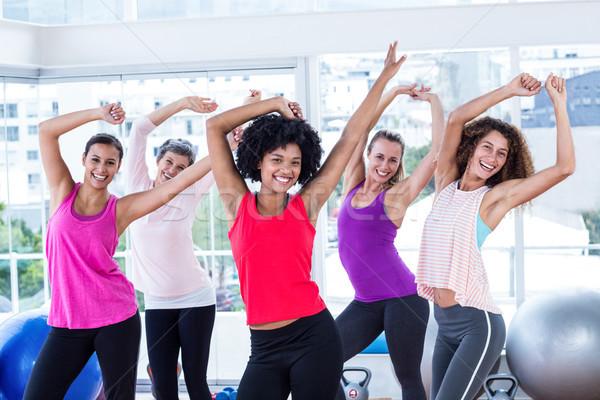 Portré nők testmozgás karok a magasban fitnessz stúdió Stock fotó © wavebreak_media