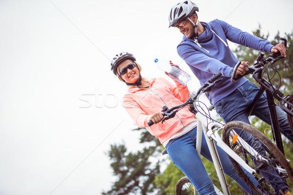 Szczęśliwy para rowerów człowiek fitness zielone Zdjęcia stock © wavebreak_media