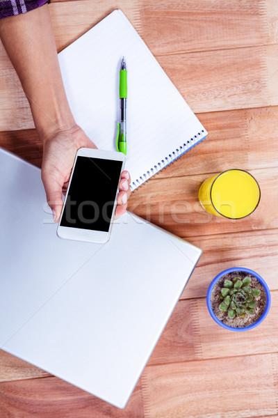 Nőies kezek tart okostelefon notebook laptop Stock fotó © wavebreak_media