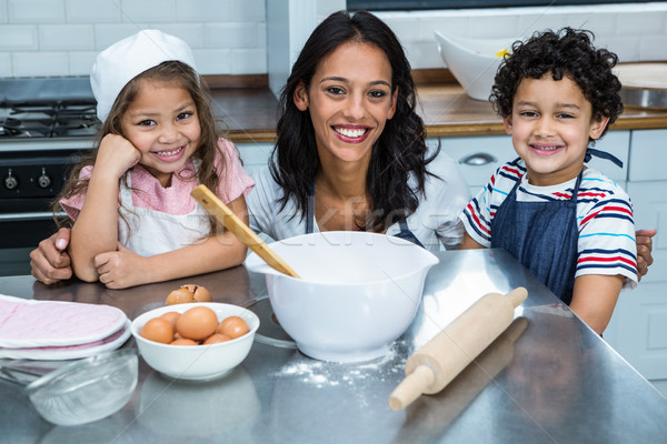 Smiling mother in the kitchen with her children Stock photo © wavebreak_media