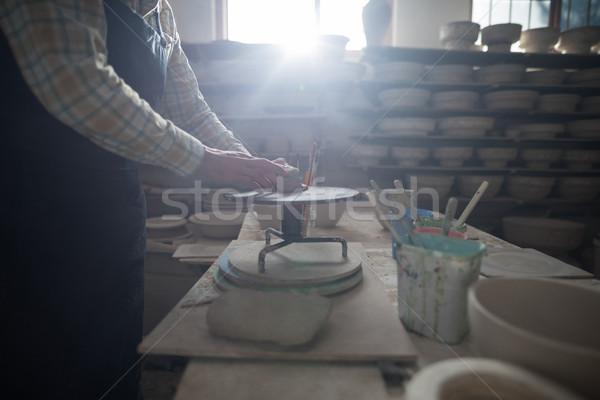 Homme argile poterie roue affaires Photo stock © wavebreak_media