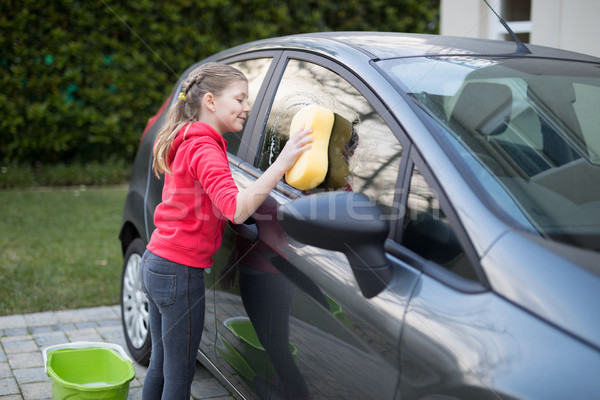 Genç kız yıkama araba su kız Stok fotoğraf © wavebreak_media