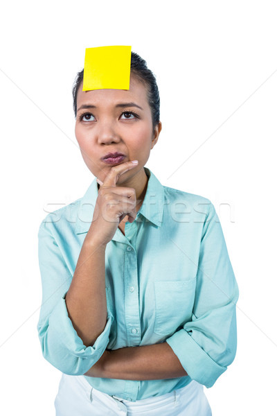 Businesswoman looking at the signe on her forehead Stock photo © wavebreak_media