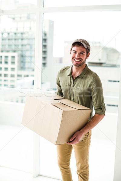 Сток-фото: улыбаясь · почтальон · пакет · служба · человека