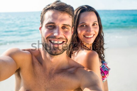 Rear view of couple sitting by the pool Stock photo © wavebreak_media