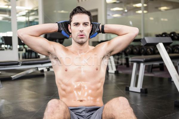 Shirtless man doing sitting up Stock photo © wavebreak_media