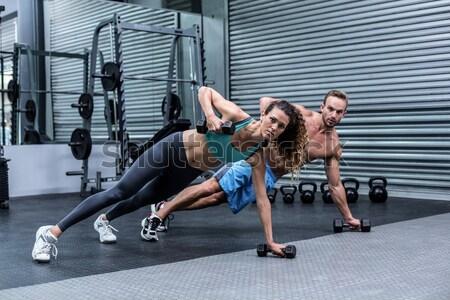 Muskularny człowiek w górę crossfit siłowni Zdjęcia stock © wavebreak_media