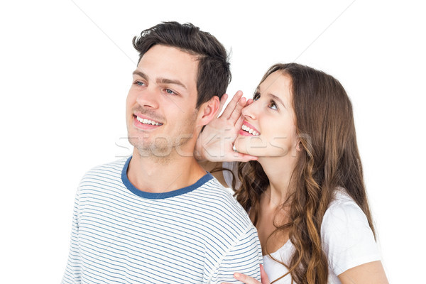 Stock photo: Young couple sharing a secret