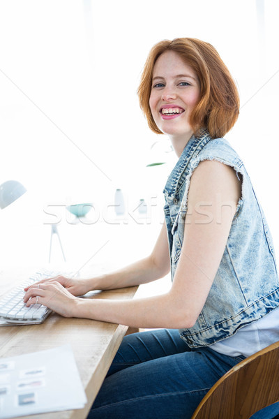 smiling hipster businesswoman sitting at her computer Stock photo © wavebreak_media