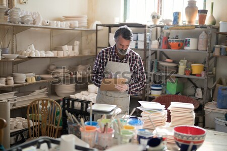 Portrait of male potter holding bowl Stock photo © wavebreak_media