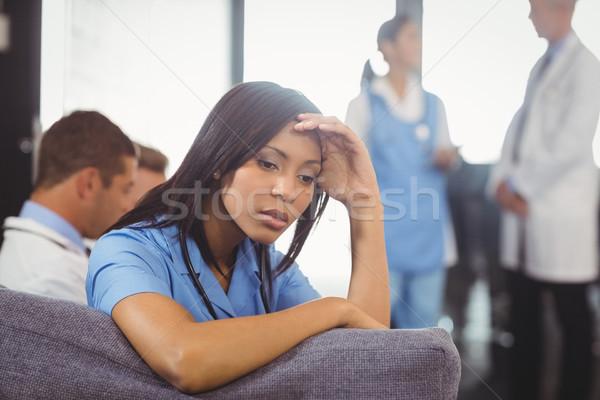 Tensed doctor sitting on sofa Stock photo © wavebreak_media