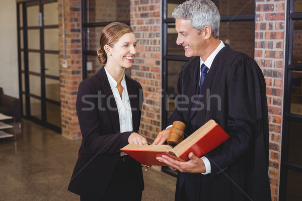 Homme avocat livre Homme collègue Photo stock © wavebreak_media