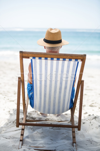 зрелый человек расслабляющая палуба Председатель пляж морем Сток-фото © wavebreak_media
