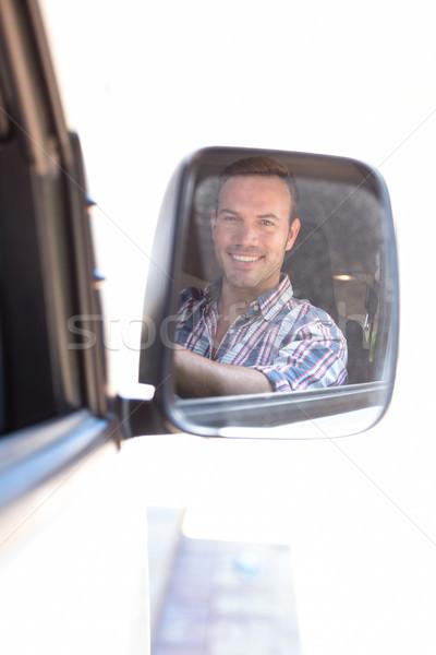 Fiatalember vezetés tükröződés hátsó nézet tükör autó Stock fotó © wavebreak_media