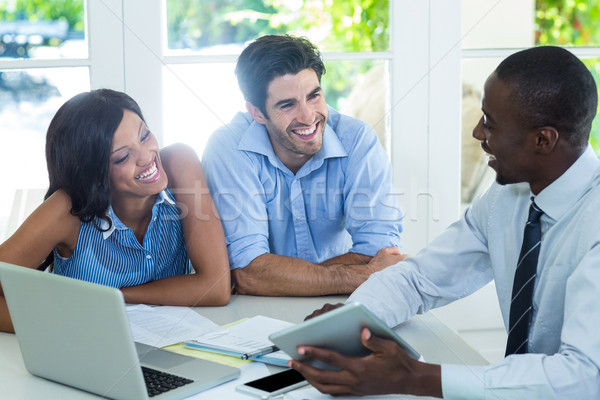Couple and real estate agent discussing together Stock photo © wavebreak_media