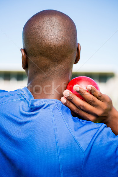 Male athlete preparing to throw shot put ball Stock photo © wavebreak_media