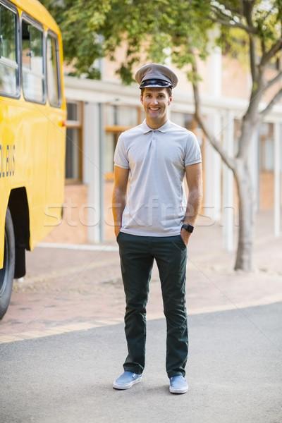 Sorridente ônibus motorista em pé mãos bolso Foto stock © wavebreak_media