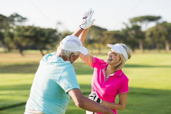 Alegre golfista Pareja máximo de cinco pie campo Foto stock © wavebreak_media