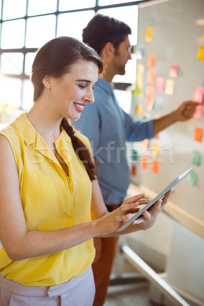 Female business executive using digital tablet Stock photo © wavebreak_media