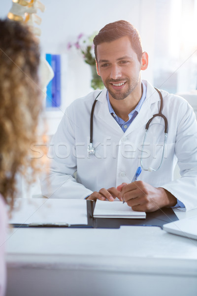 Physiotherapist explaining diagnosis to female patient Stock photo © wavebreak_media