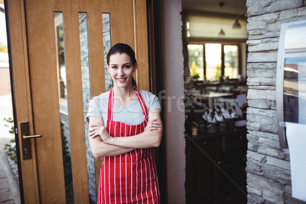 Portrait of female baker standing with arms crossed Stock photo © wavebreak_media