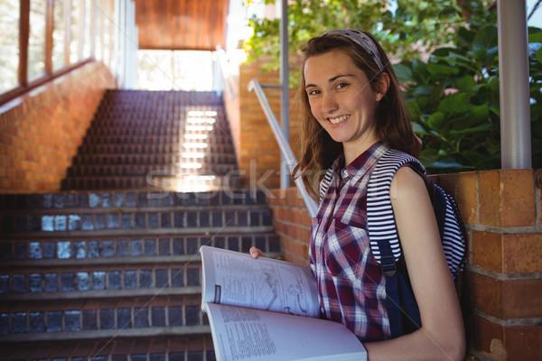 портрет школьница чтение книга лестница школы Сток-фото © wavebreak_media