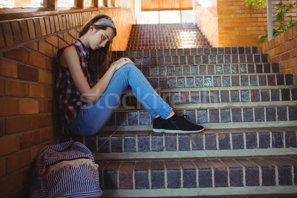 Triest schoolmeisje vergadering alleen trappenhuis school Stockfoto © wavebreak_media