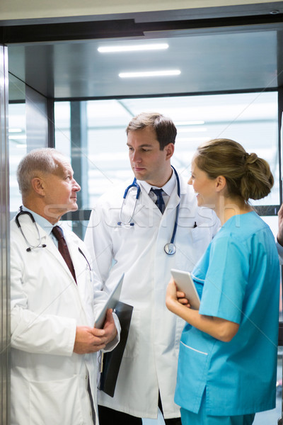 Doctors and surgeon interacting with each other in elevator Stock photo © wavebreak_media